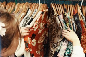 Woman sorts through clothes at a thrift store