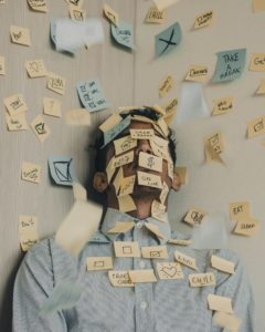 Man covered in post-it notes, stress