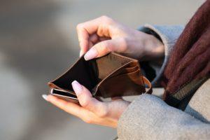 Empty wallet, woman has no cash, in need of a loan