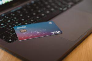 Credit card sitting on laptops